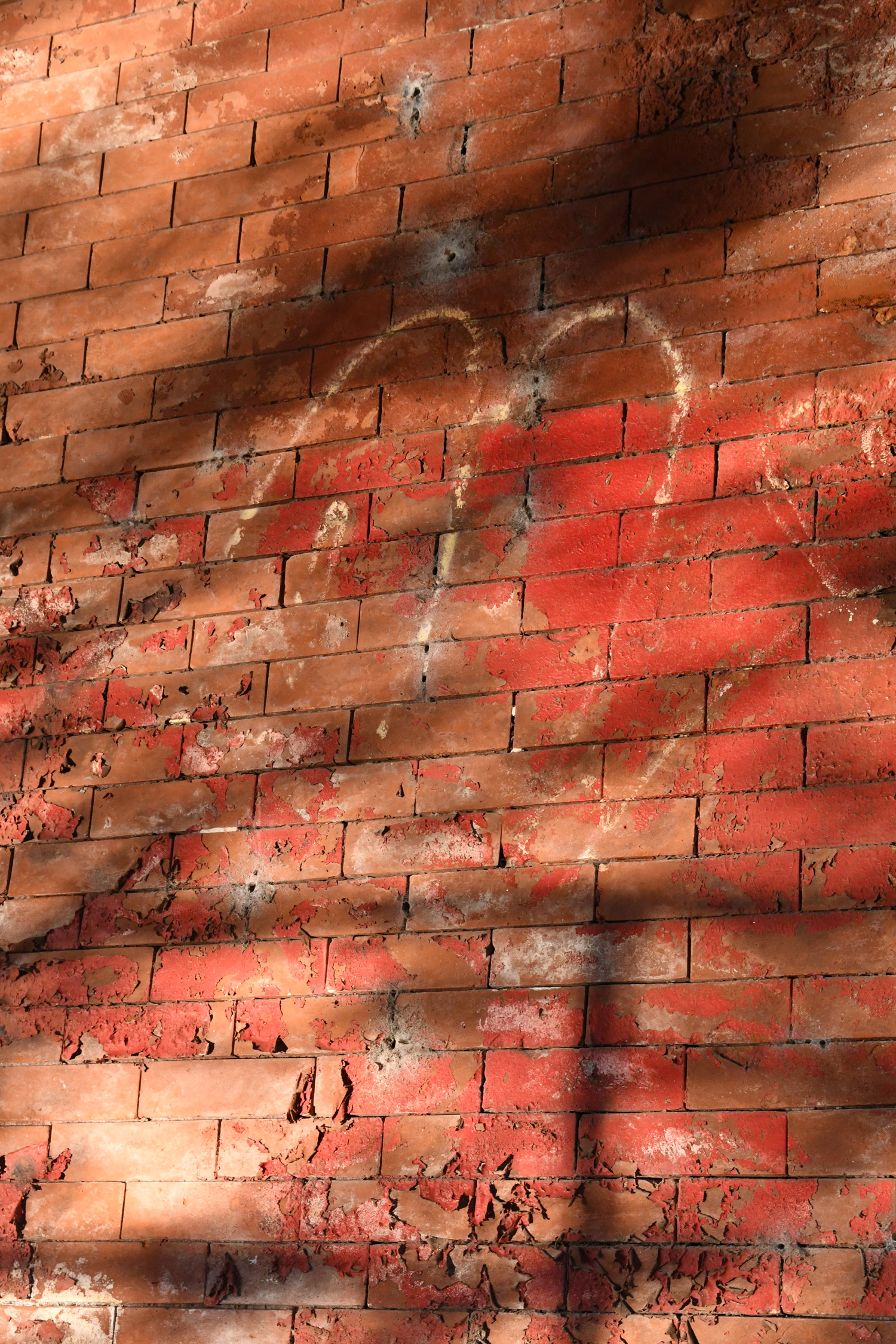 Light reflected off of water onto brick, Prospect Park